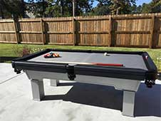 Debbie Robinson from AR getting a game of pool in on her outdoor pool table