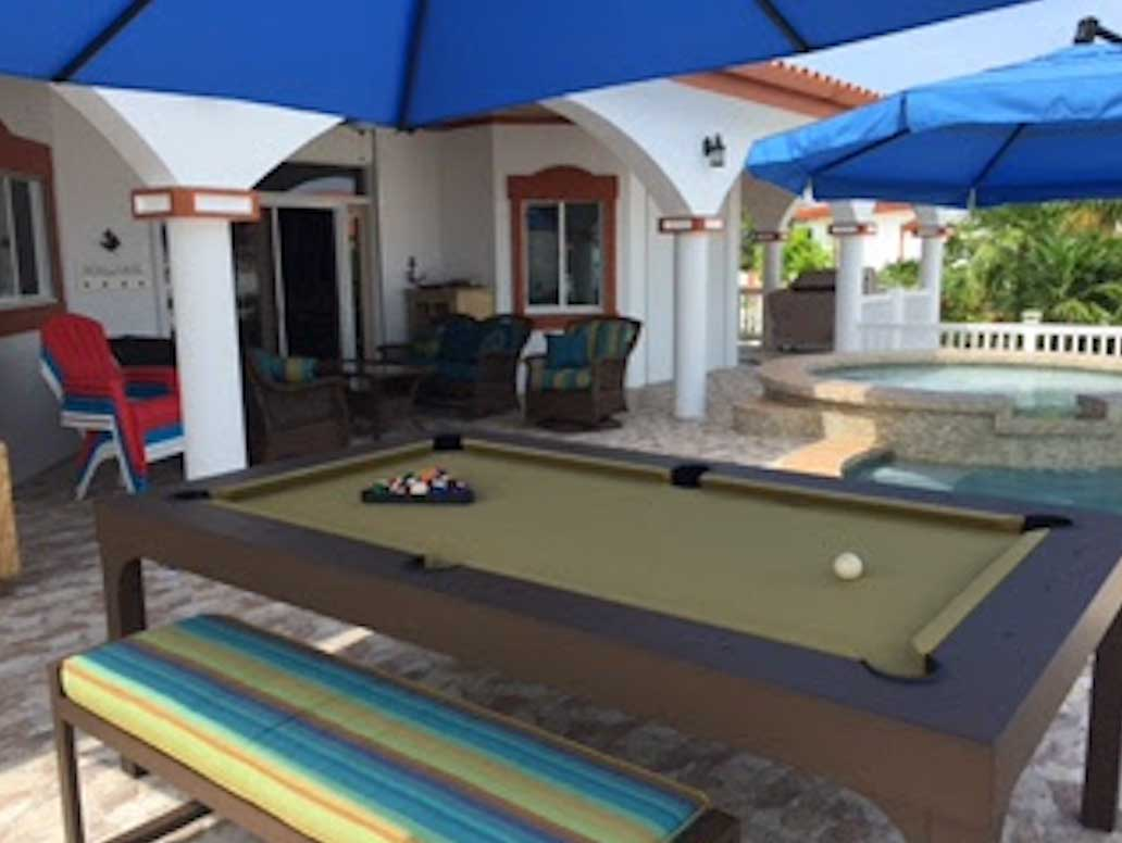 Brown and Green Balcony outdoor pool table with matching All Weather bench seating and cushions