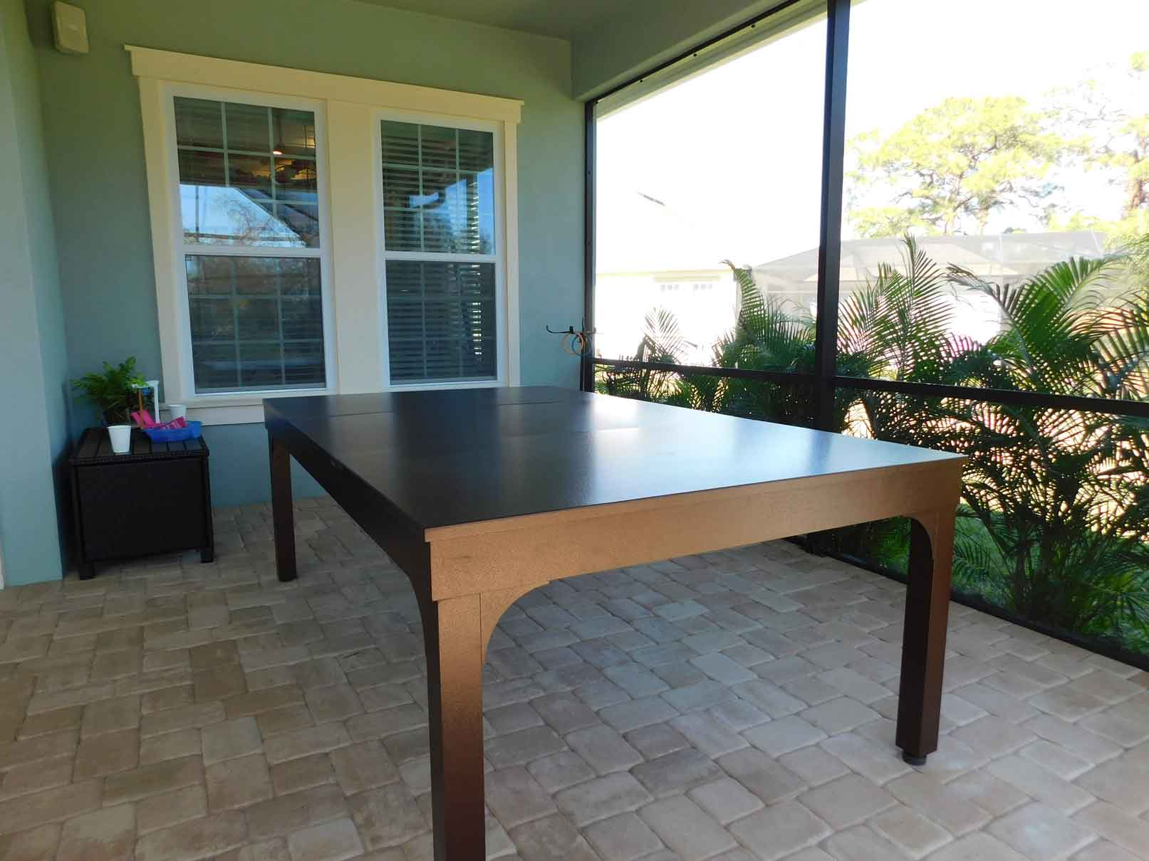 Custom outdoor pool table with dining conversion top from R&R Outdoors All Weather Billiards