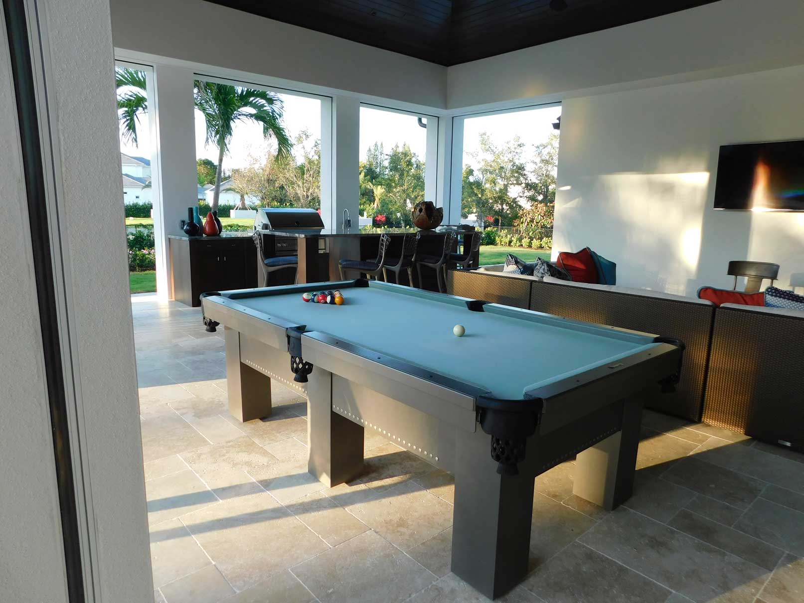Custom outdoor pool table with stylish embellishments from R&R Outdoors All Weather Billiards