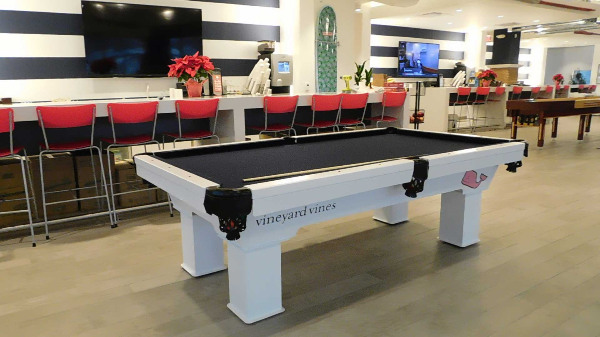 Vineyard Vine's custom outdoor pool table with company logo from R&R Outdoors All Weather Billiards
