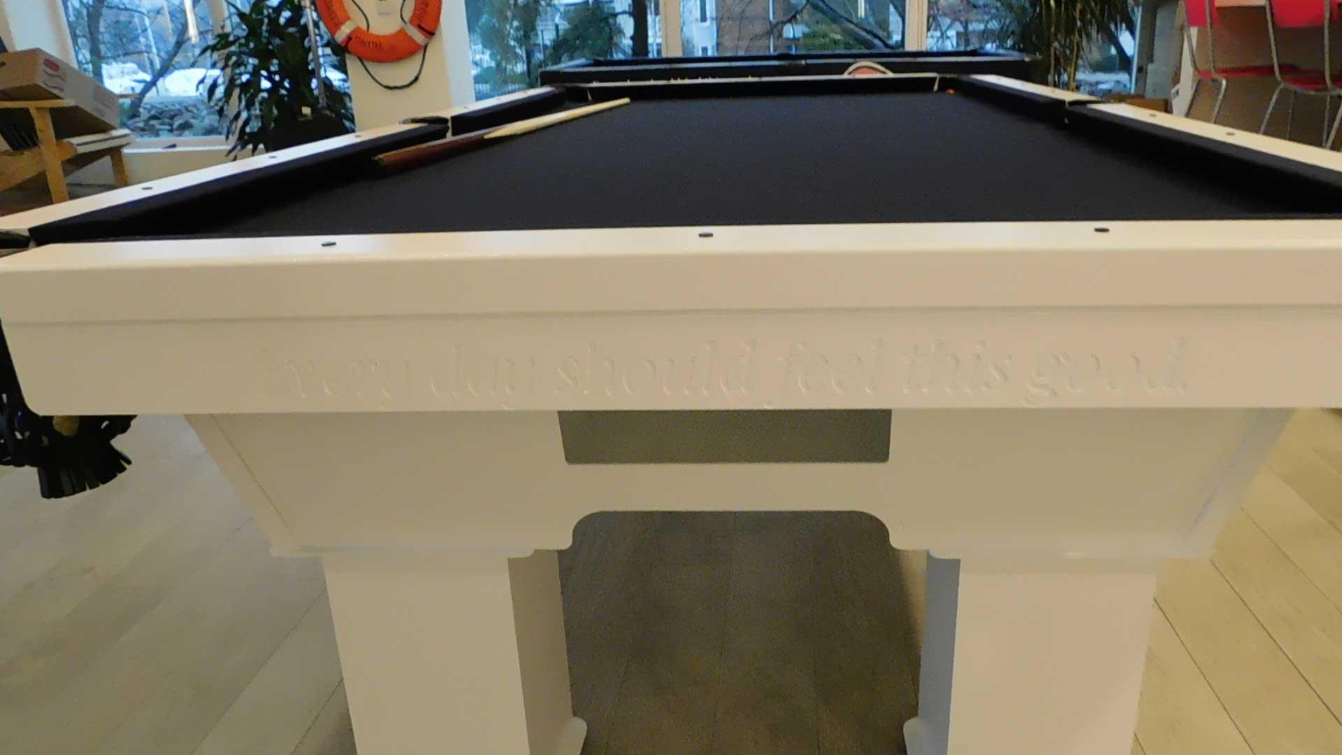 Vineyard Vine's custom outdoor pool table with engraved company slogan