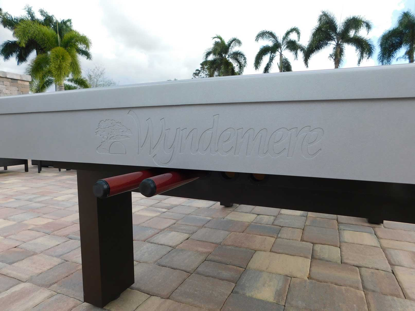 Custom outdoor pool table with engraved company logo from R&R Outdoors All Weather Billiards