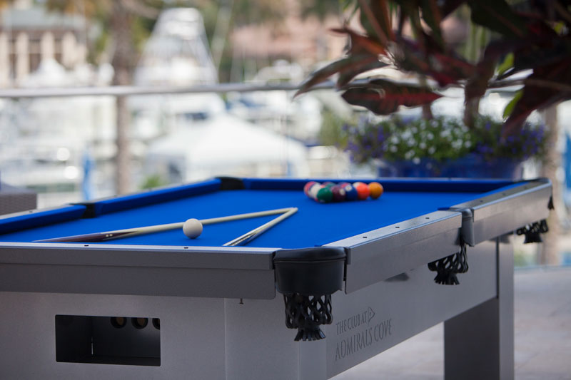 Custom outdoor pool table for Admiral's Cove club with logo engraved
