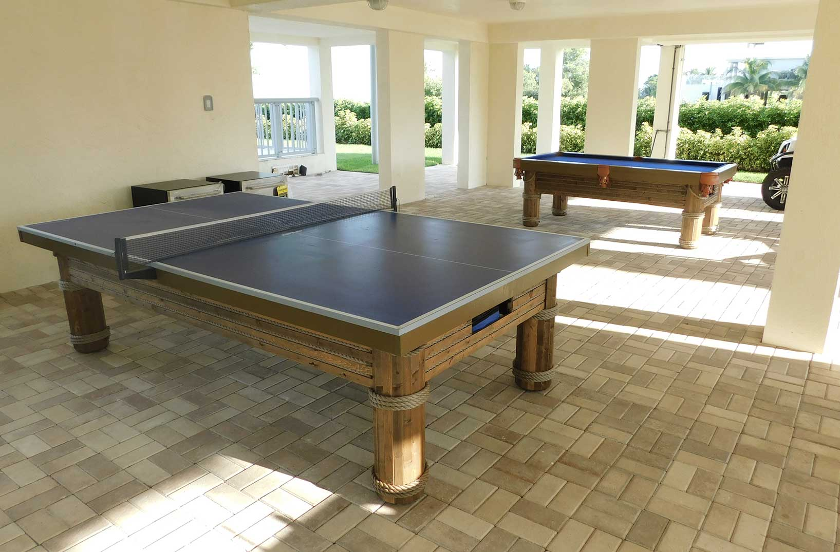 Southwest Florida home with Caribbean Outdoor Pool Table and Caribbean Outdoor Table Tennis Table from R&R Outdoors All Weather Billiards