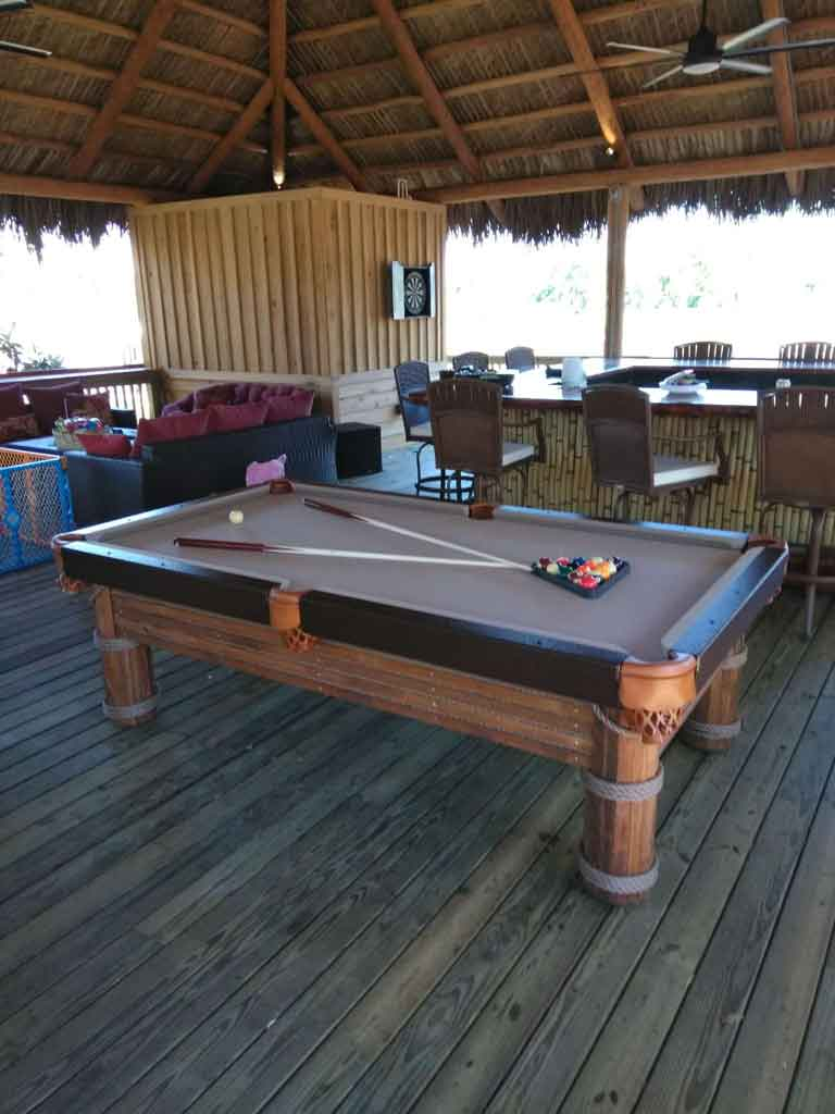 Caribbean Outdoor Pool Table at Outside Bar Area from R&R Outdoors, Inc. All Weather Billiards