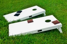 White, custom, outdoor cornhole set with black and brown beanbags