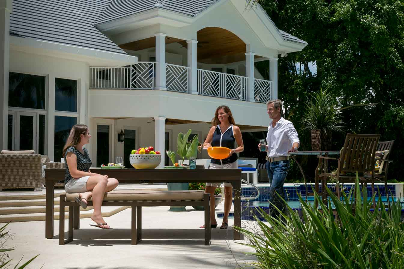 Family enjoying their outdoor entertaining space with a custom outdoor pool table converted for dining