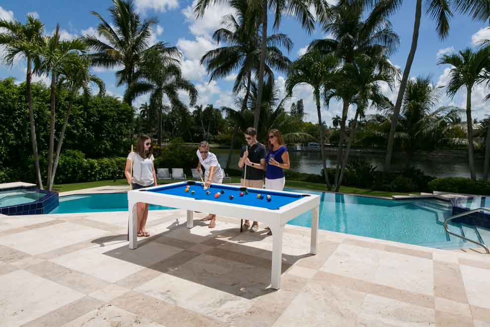 Family enjoying their South Beach custom outdoor pool table from R&R Outdoors, Inc. All Weather Billiards
