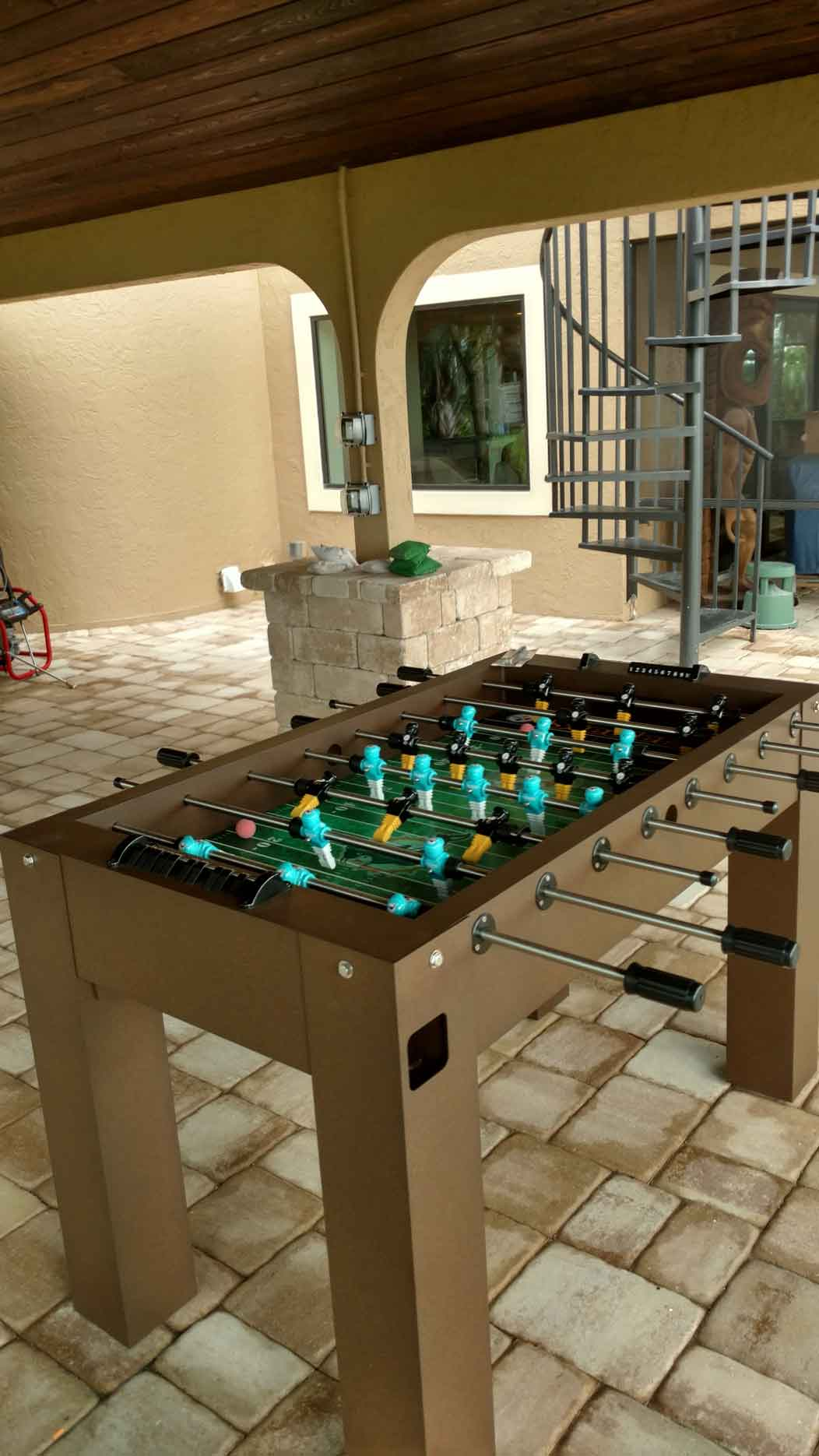 Custom outdoor foosball game table with Miami Dolphins and Pittsburgh Steelers players