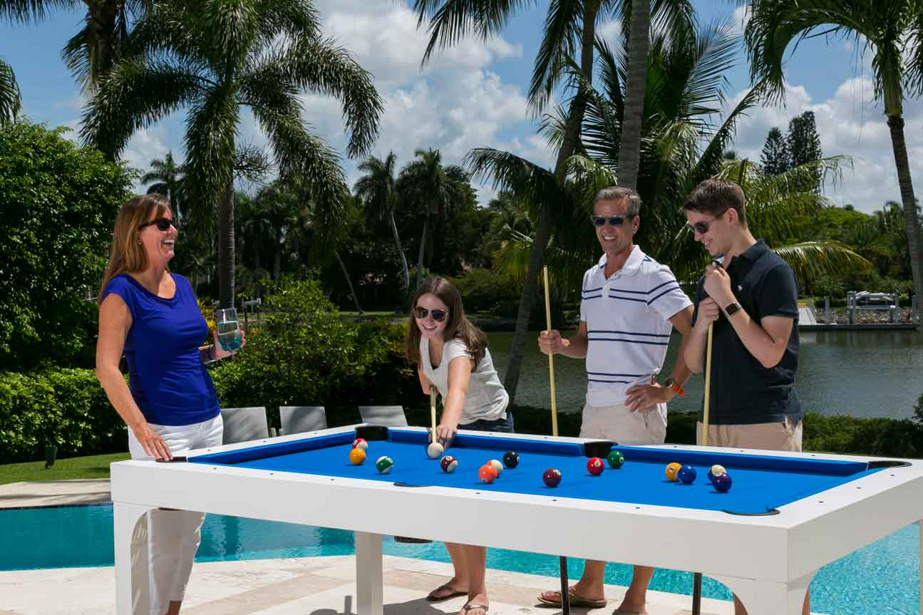 Family enjoying R&R Outdoors All Weather Billiards Balcony pool table