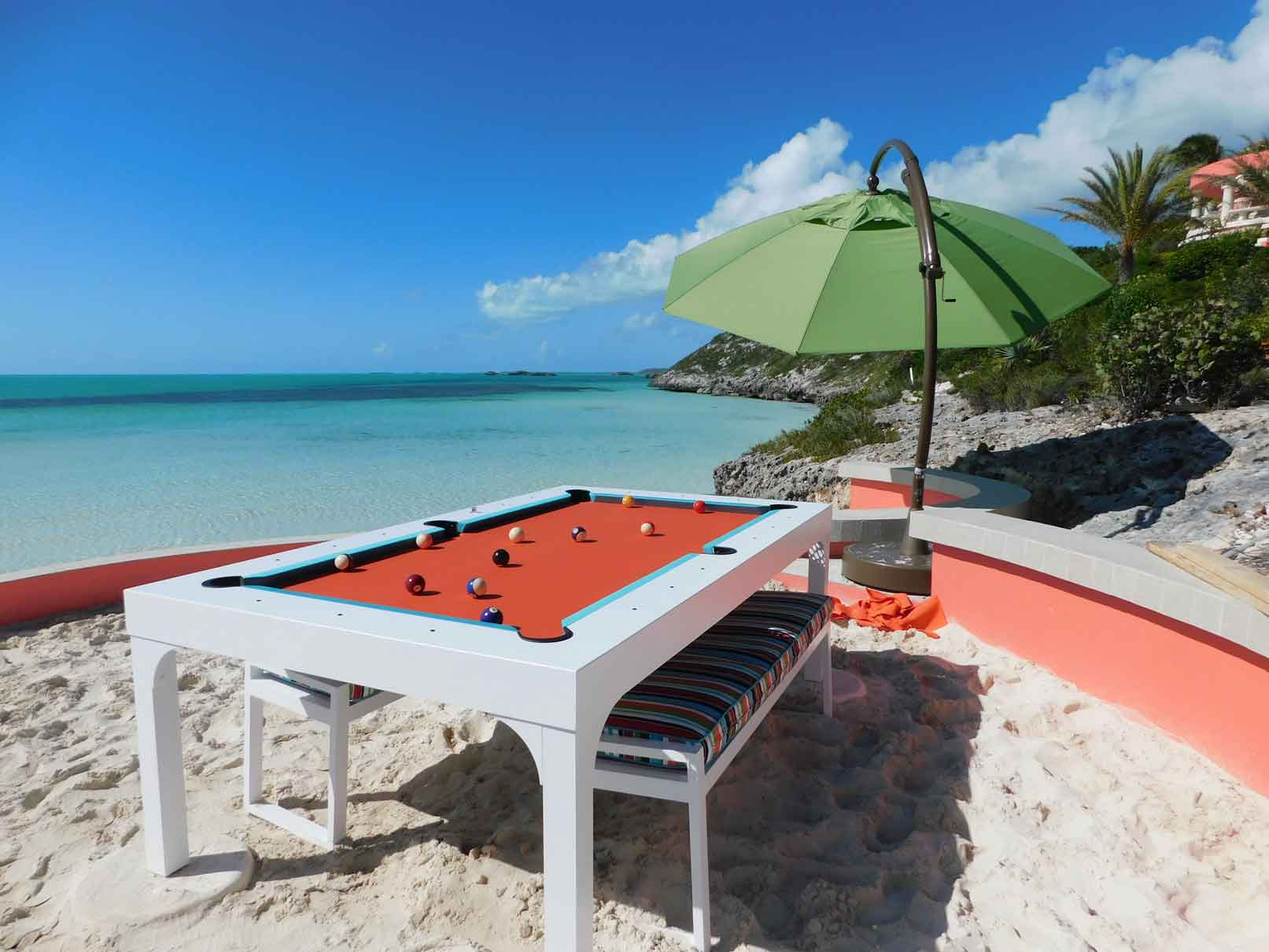 White Balcony outdoor pool table with all weather benches sits oceanfront in the British Virgin Islands