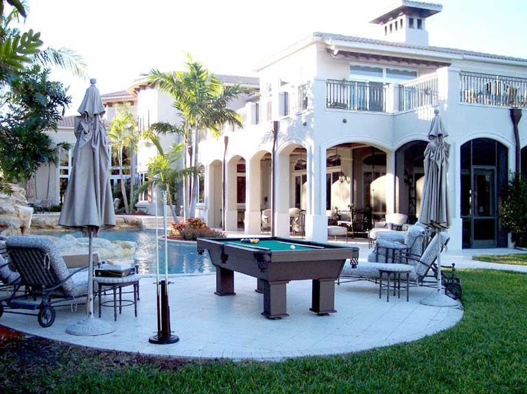 The Caesar, outdoor pool table, by R&R Outdoors All Weather Billiards outside client's home in Southwest Florida