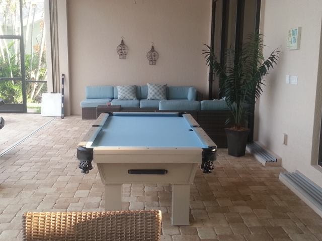 Caesar custom pool table client's outdoor living space by R&R Outdoors All Weather Billiards