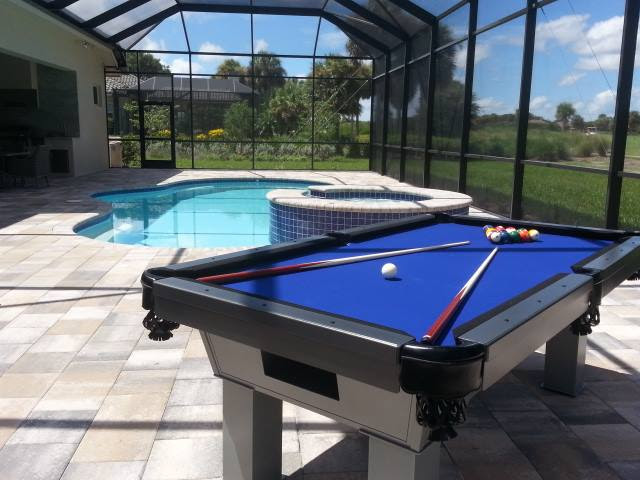 Caesar outdoor pool table poolside in client's lanai