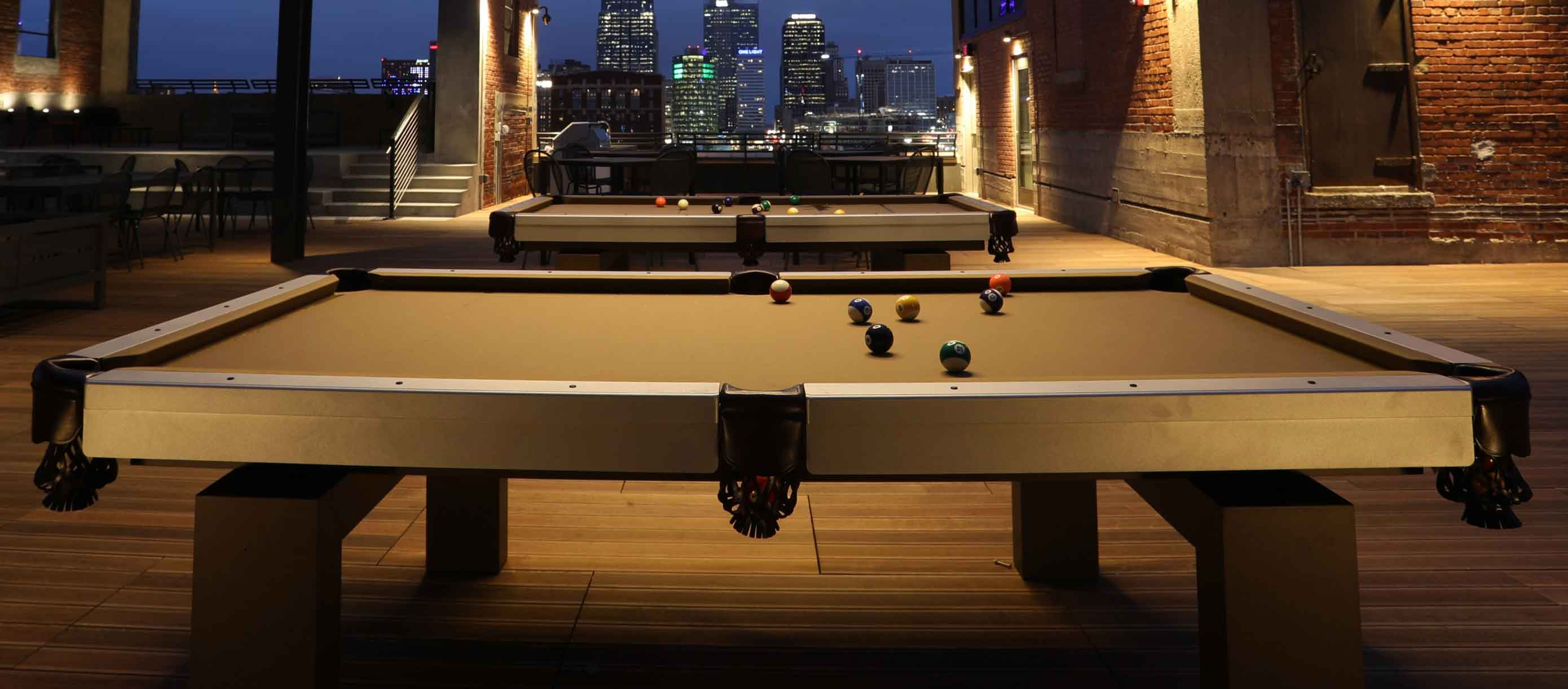 Oasis custom outdoor pool table by R&R Outdoors All Weather Billiards on rooftop