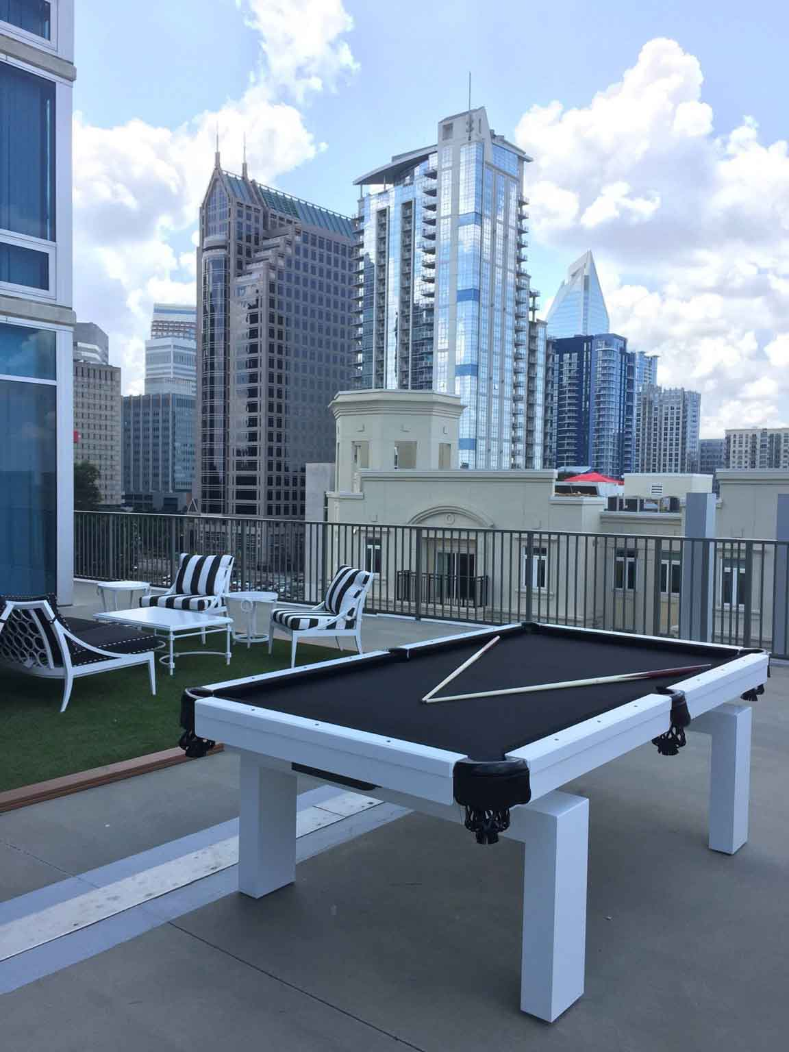Black and white Oasis custom pool table on rooftop building in North Carolina