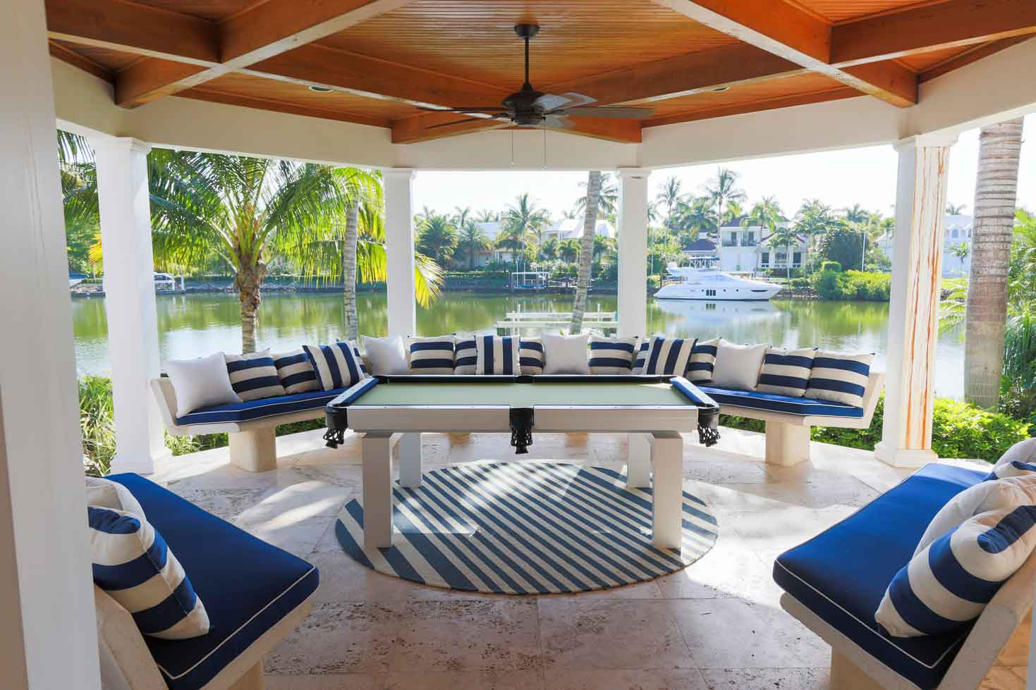 Blue and white Oasis custom outdoor pool table in client's waterfront gazebo in Southwest Florida