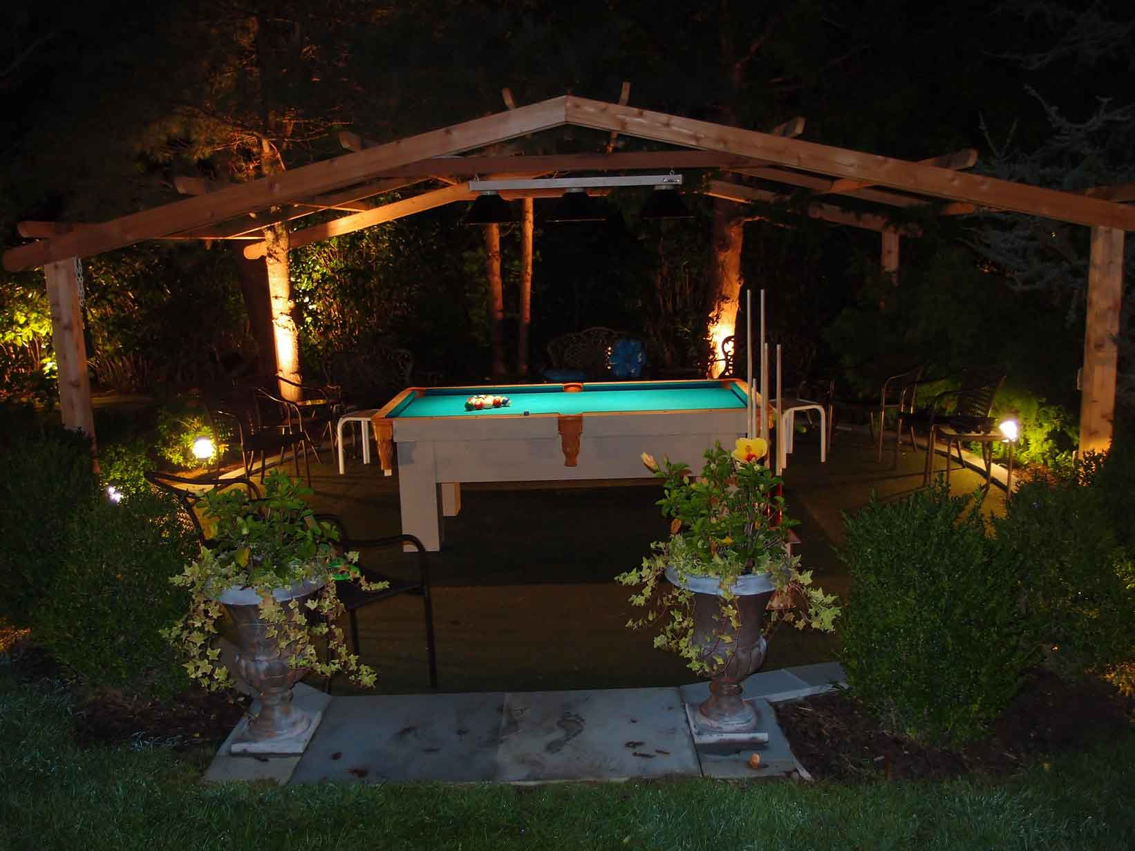 Orion custom pool table as the focal point of client's outdoor living space