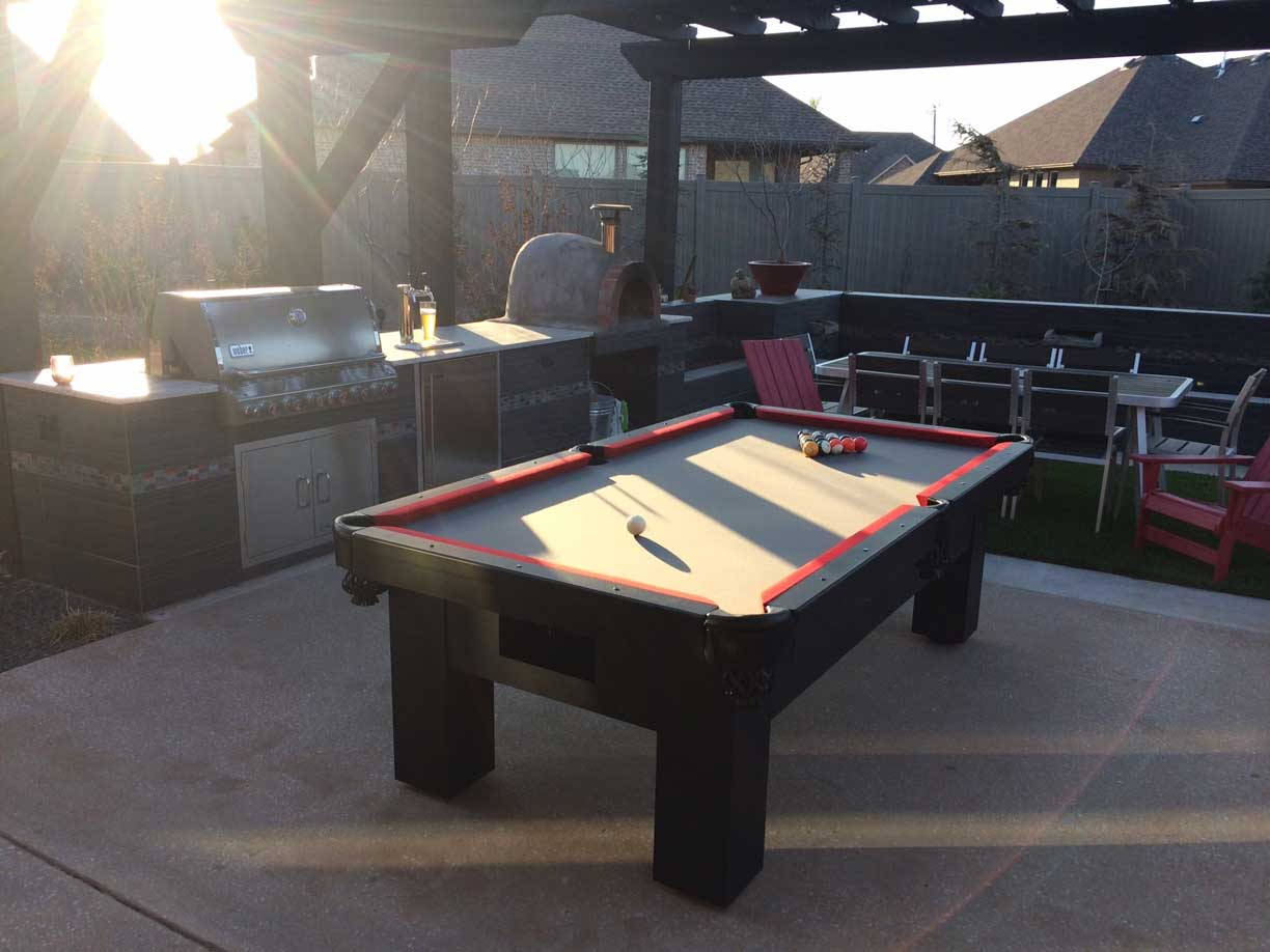R&R Outdoors All Weather Billiards Orion outdoor pool table as a focal point in client's outdoor living space