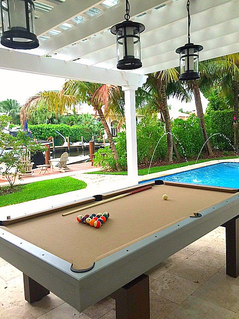 South Beach custom outdoor pool table model sits pool side for a client in Southwest Florida