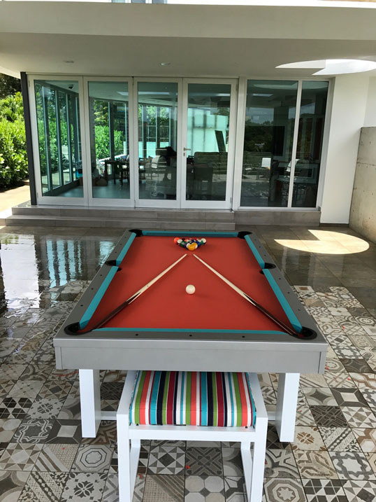 South Beach, custom outdoor pool table with matching benches, ready for hard-top dining conversion in client's outdoor living space