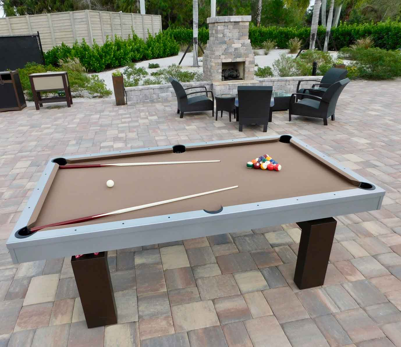 South Beach, custom outdoor pool table, creates a fun and relaxing outdoor living space