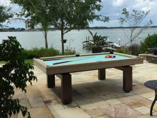 Paul and Rebecca Hart from Texas enjoy playing on their custom outdoor pool table