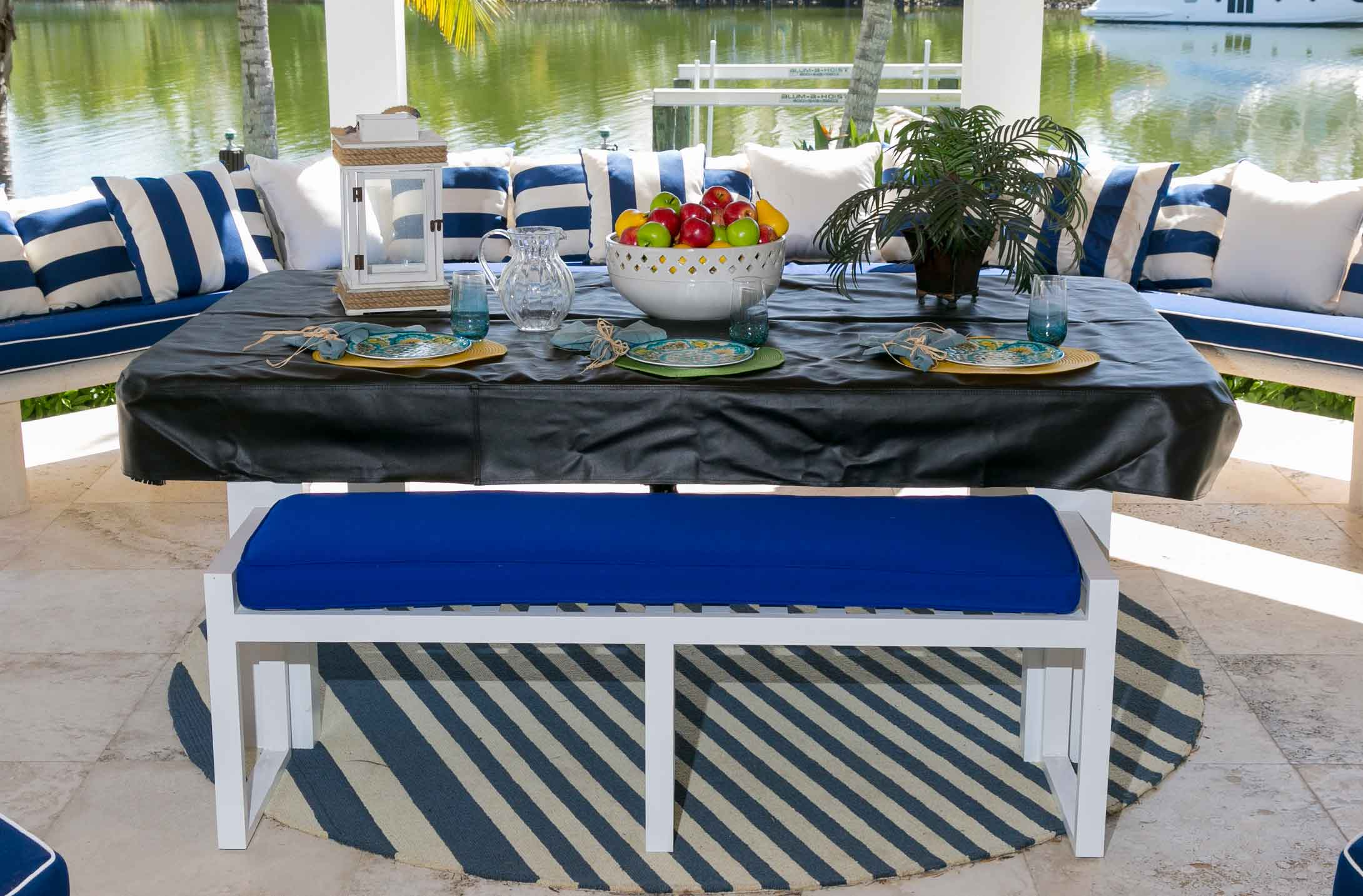Outdoor pool table transforming into a entertaining area will black custom pool table cover and all weather seating bench
