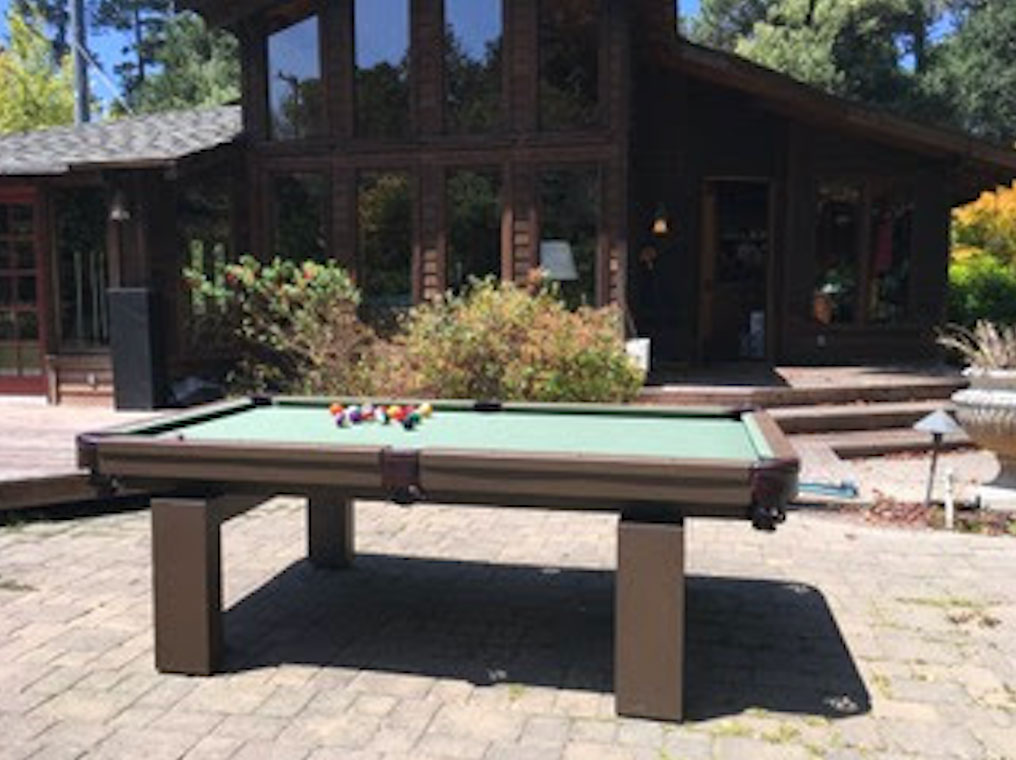 Oasis custom outdoor pool table outdoors in client's home