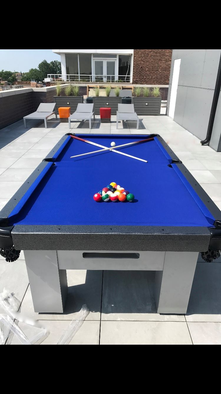 Blue and Grey Orion custom outdoor pool table in client's outdoor living space