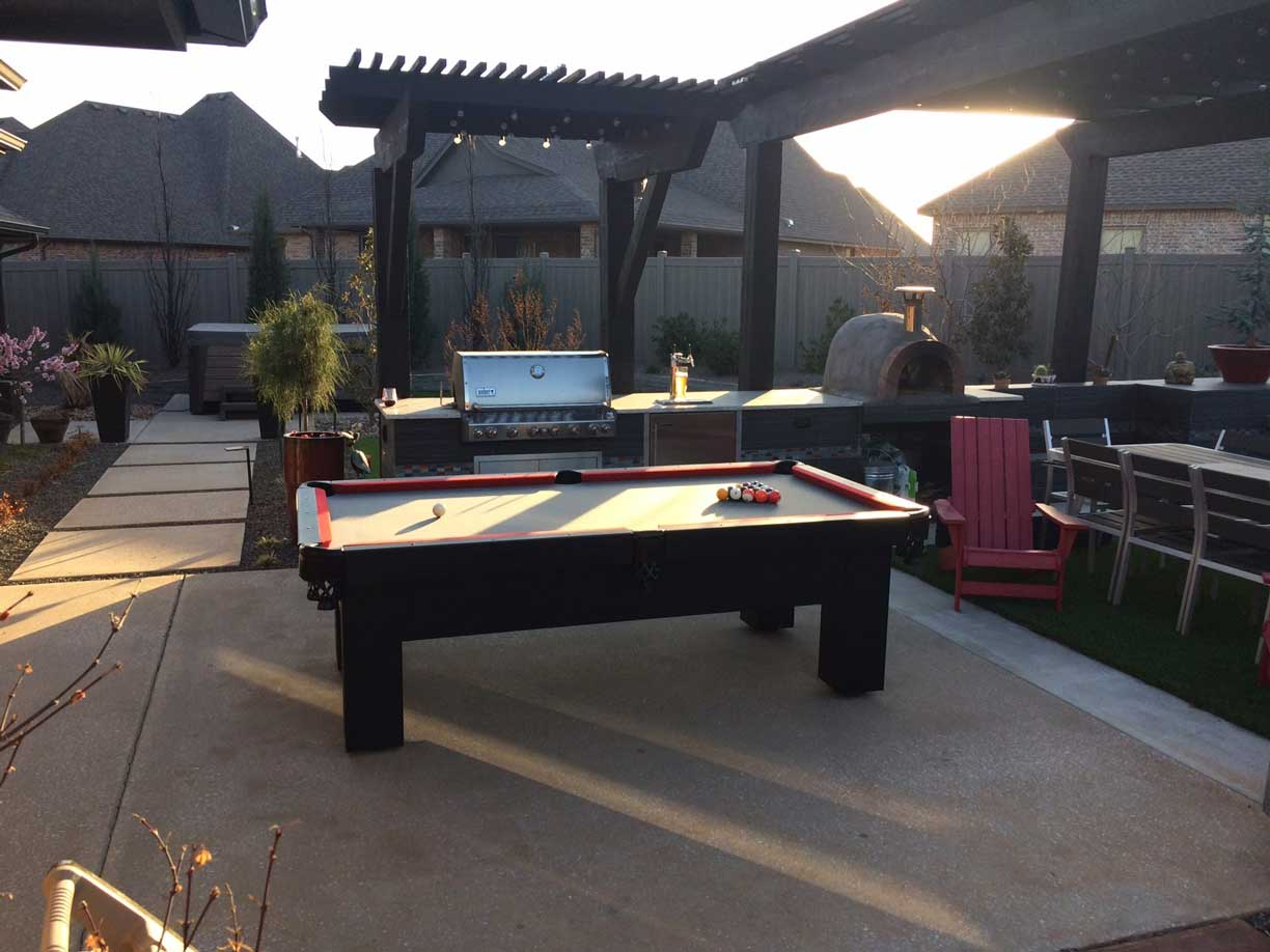 Orion Outdoor Pool Table in Residential Backyard from R&R Outdoors, Inc.
