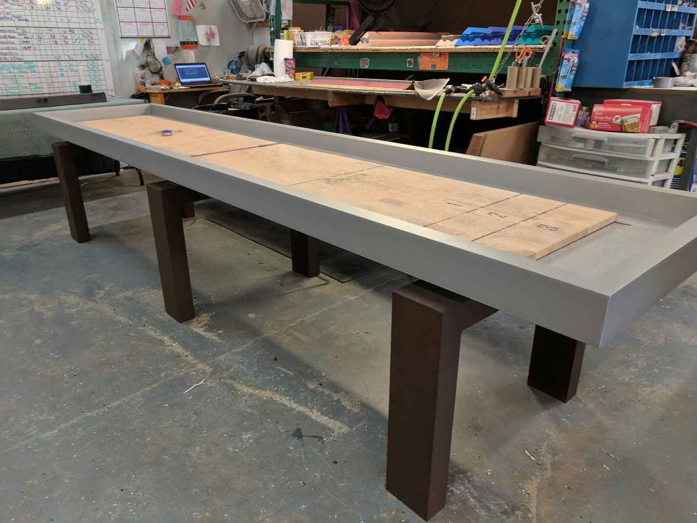 Custom outdoor shuffleboard table in production at R&R Outdoors All Weather Billiards manufacturing facility
