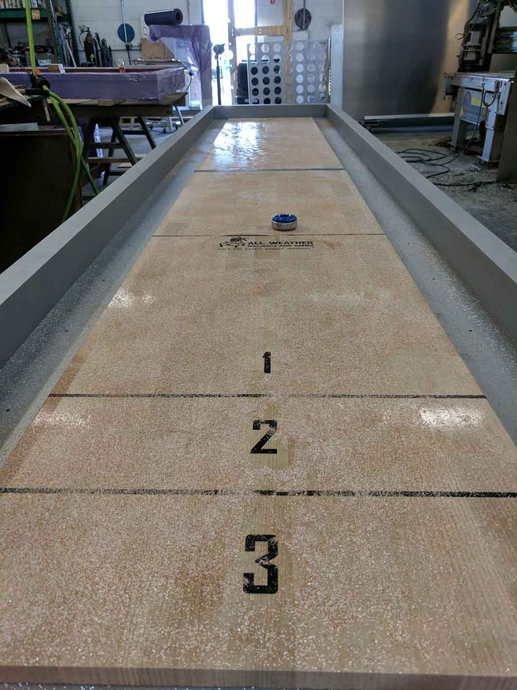 Top view of custom, outdoor shuffleboard game table by R&R Outdoors All Weather Billiards