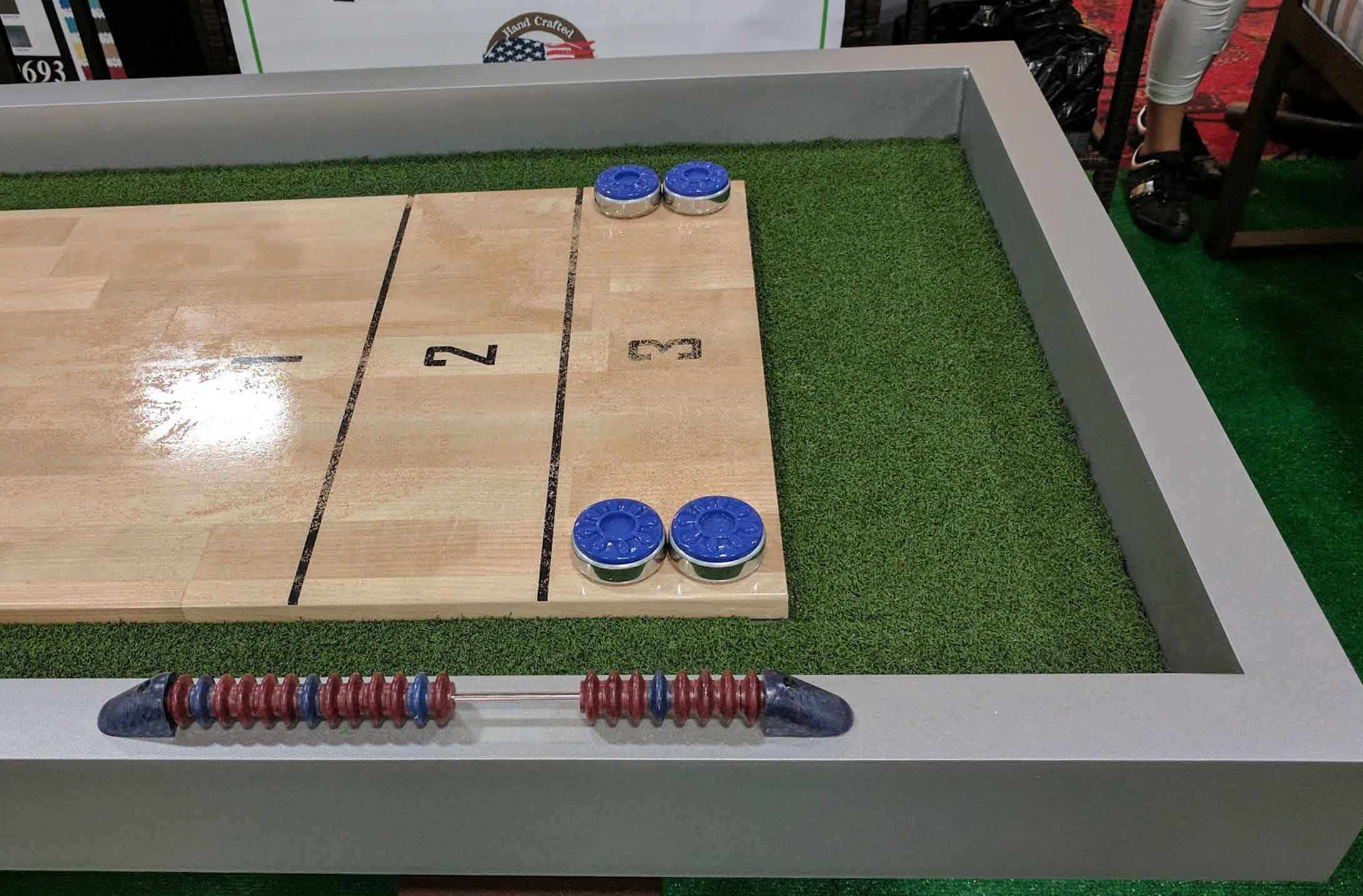 Close up image of playing surface on R&R Outdoors All Weather Billiards Rock Solid Shuffleboard game table