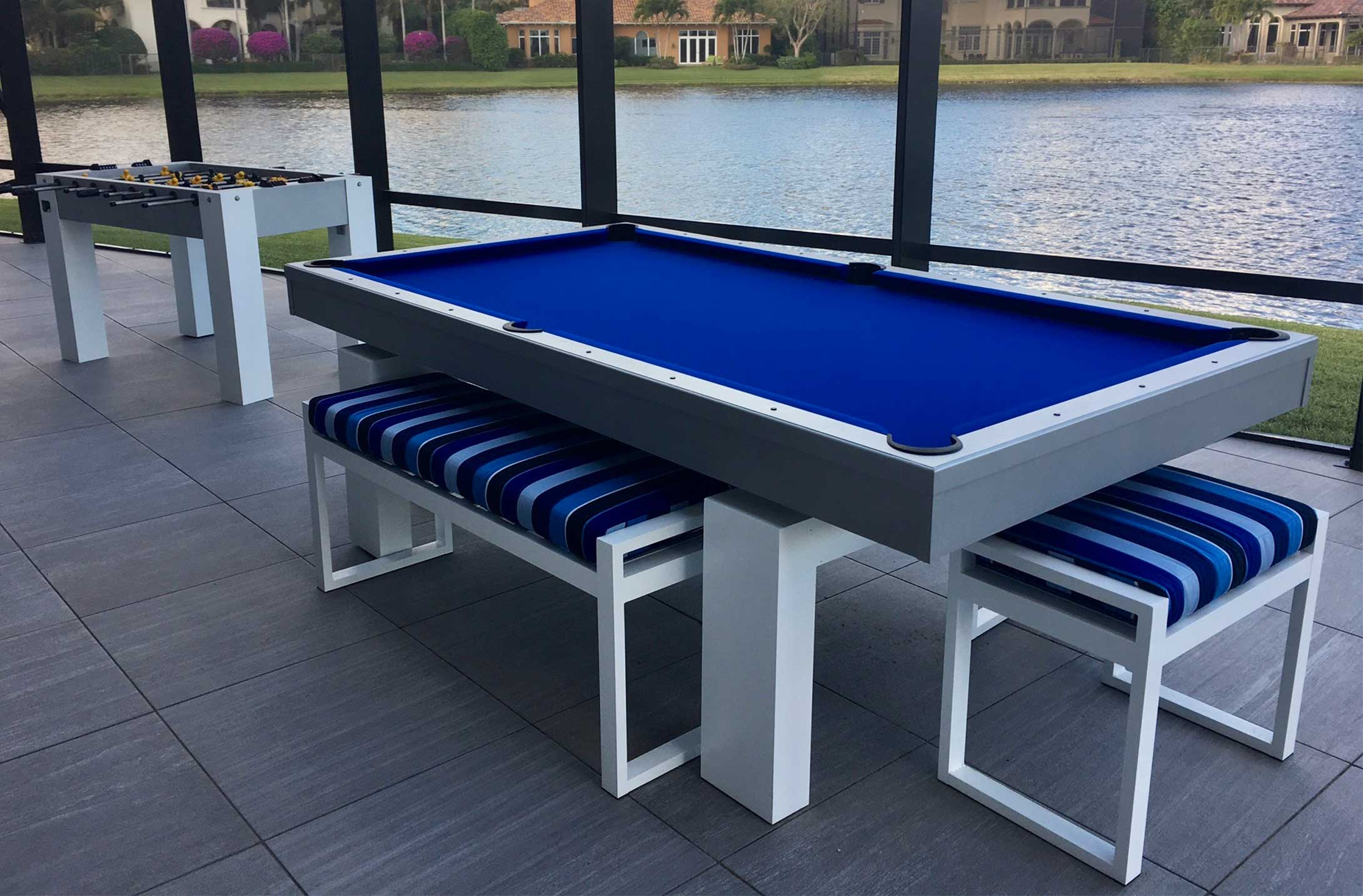 South Beach model custom outdoor pool table alongside custom foosball game table in client's Southwest Florida lanai