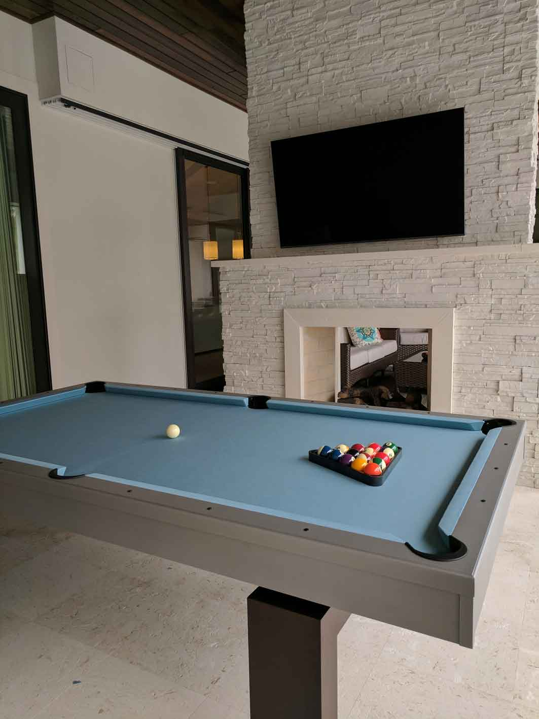 South Beach custom outdoor pool table in client's outdoor living space
