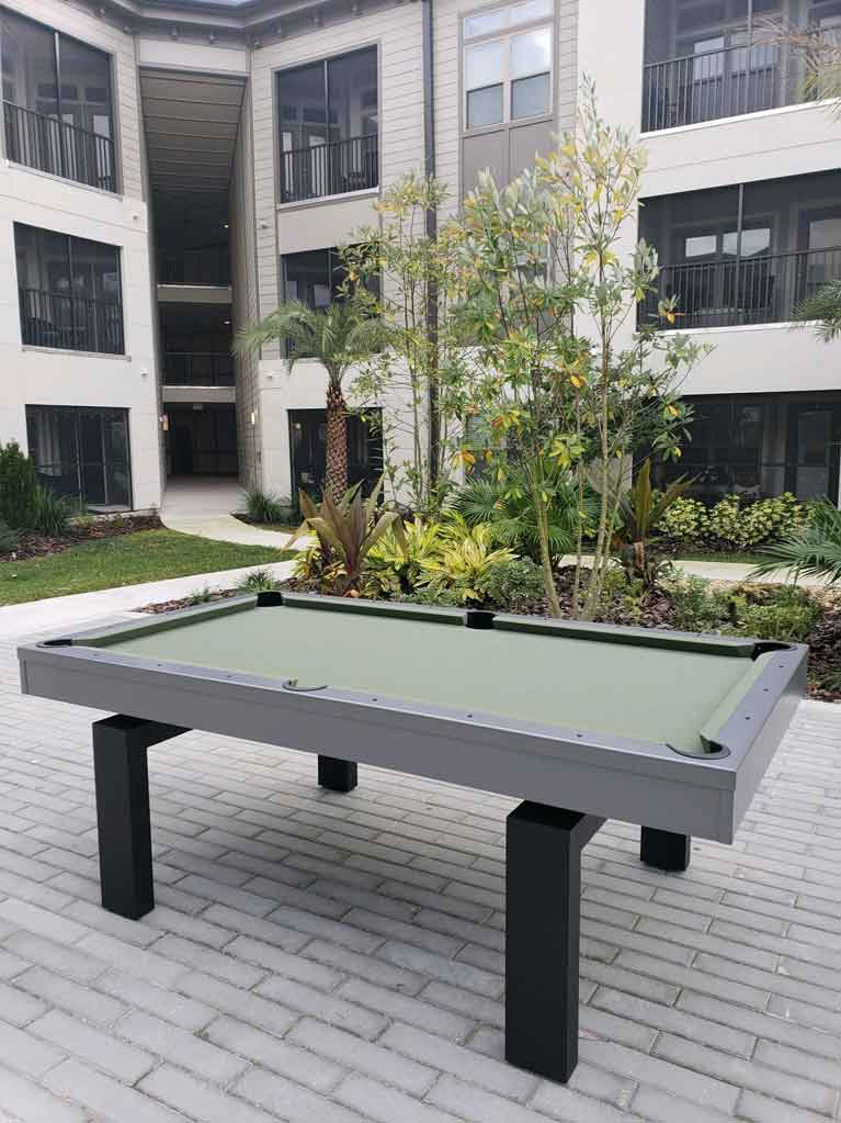 South Beach Outdoor Pool Table in Apartment Complex Courtyard