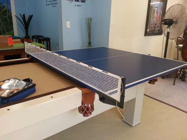 Close up of custom outdoor pool table with sample of table tennis conversion top in R&R Outdoors All Weather Billiards showroom