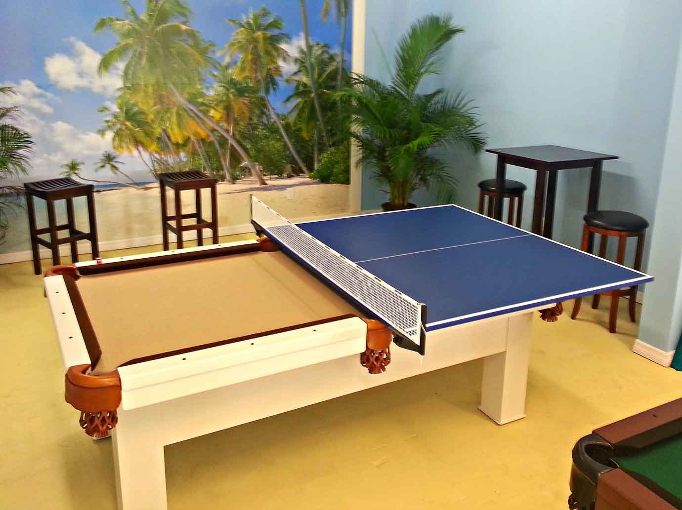 Custom outdoor pool table with sample of table tennis conversion top in R&R Outdoors All Weather Billiards showroom