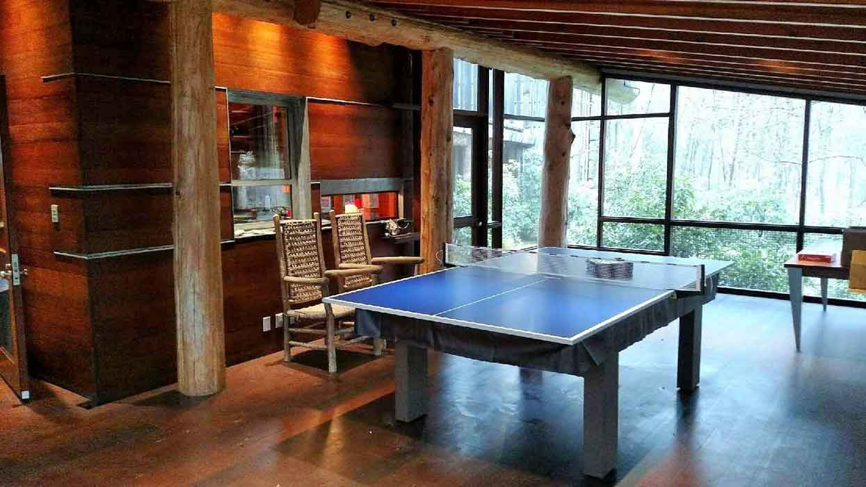 Custom pool table with table tennis conversion top and black vinyl pool table cover