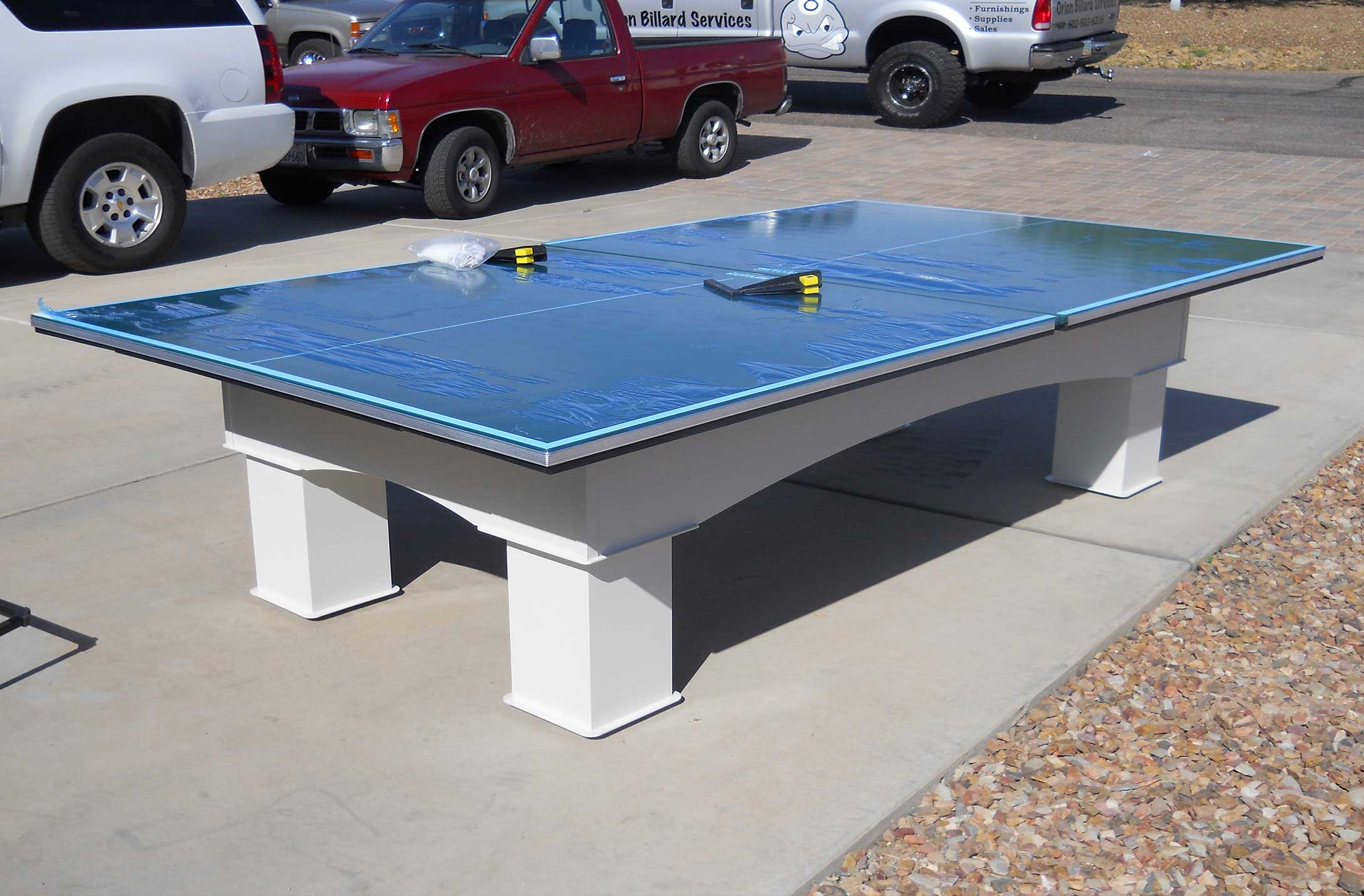 Outdoor table tennis game table waiting to be installed in client's home