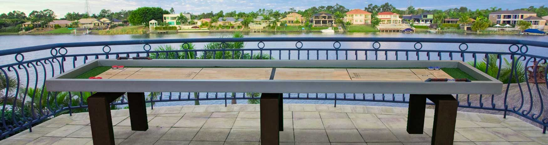 Outdoor Shuffleboard game table on patio overlooking the water